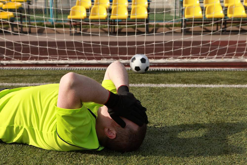 Football,Player,Covers,Own,Face.,The,Goalkeeper,During,The,Game